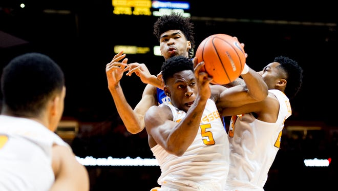 Tennessee forward Admiral Schofield (5) grabs the rebound during a game between Tennessee and Kentucky at Thompson-Boling Arena in Knoxville, Tennessee on Saturday, January 6, 2018.