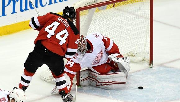 Detroit Red Wings goaltender Petr Mrazek (34) deflects