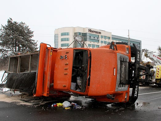 DelDOT plow truck overturned on northbound I-95 near Airport Road exit.