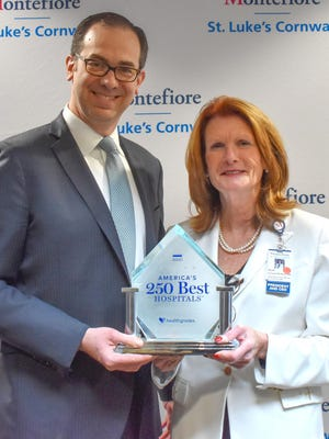 David Potack, Chairman of the MSLC Board of Trustees and Joan Cusack-McGuirk, MSLC President and CEO with the America's 250 Best Hospital's Trophy from Healthgrades.