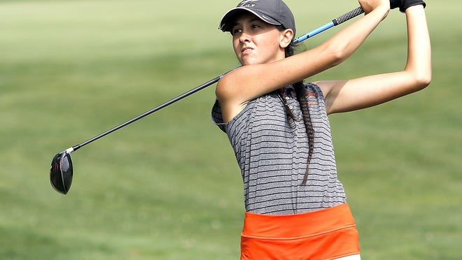 Ashland High's Kira Moore hits a tee shot during the George Valentine Invitational on Monday at Brookside Golf Course. Moore and the Arrows placed third at the invite.