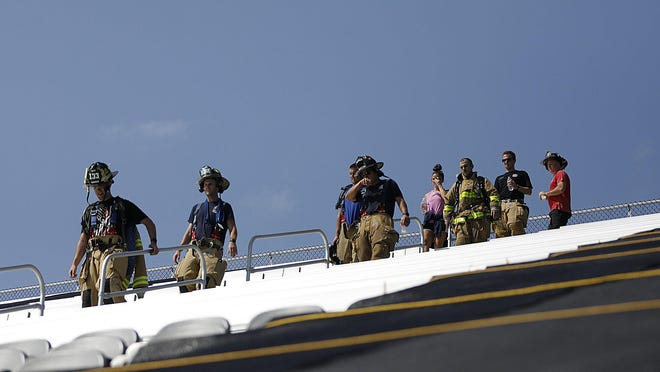 Participants head down stadium steps during the Columbus 9/11 Memorial Stair Climb at Fortress Obetz on Saturday. Nearly 270 people climbed what amounted to 110 flights, which represents the number of floors in the World Trade Center. Each person paid tribute to a first-responder who died on Sept. 11, 2001.