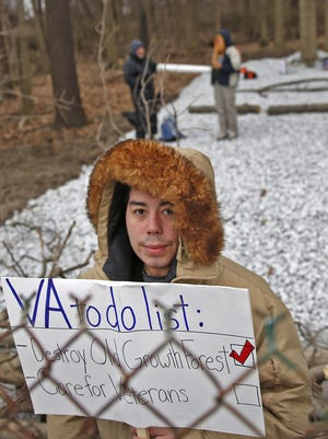 Martin Bravo joins a protest against an old-growth forest tree removal for a Veteran Affairs project, at Crown Hill Cemetery, Monday, March 13, 2017.