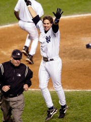 New York Yankees' Aaron Boone celebrates his solo home run in the eleventh inning to beat the Boston Red Sox in Game 7 of the American League Championship Series Thursday, Oct. 16, 2003 in New York. The Yankees won 6-5.