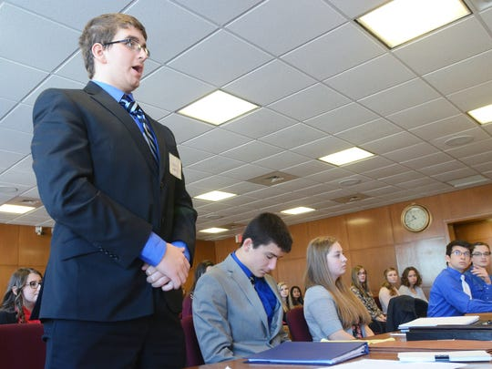 Memphis High team member Justin Rabine addresses the courtroom Saturday during the Mock Trial competition at the St. Clair County Courthouse.