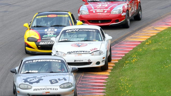 Todd Lamb leads a tight pack of Spec Miata cars during the Group 4 SCCA Majors Tour race at Watkins Glen.