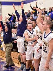 Teammates go wild as Casey Hoover of Greencastle follows