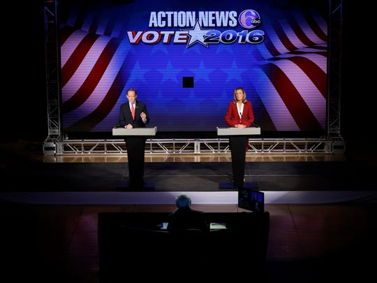 Republican Sen. Pat Toomey and Democratic challenger Katie McGinty take part in a debate in Philadelphia on Oct. 24, 2016.
