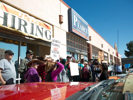 A group of  protesters with the Indivisible stood in front of U.S. Rep. Steve Pearce's Las Cruces office on Thursday, Feb. 16, 2017, where they gathered to demand Pearce appear in person to speak with them.