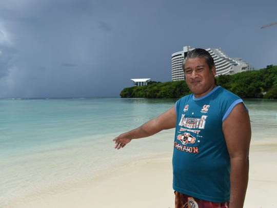 Dededo resident Dominic Togolmai, 48, points to the