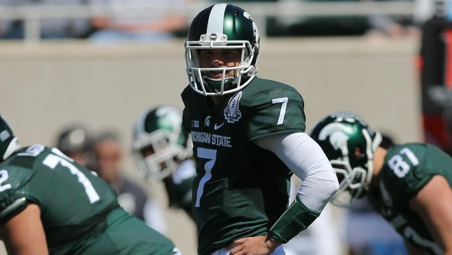 MSU quarterback Tyler O'Connor, one of four vying to be the starter, threw for 138 yards and a touchdown in Saturday's intrasquad scrimmage.