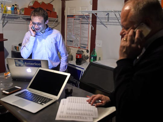 Jonathan George and Gary Bynum make calls from the