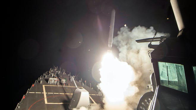 The USS Ross (DDG 71) fires a tomahawk land attack missile from the Mediterranean Sea. The United States blasted a Syrian air base with a barrage of cruise missiles in fiery retaliation for this week's chemical weapons attack against civilians.