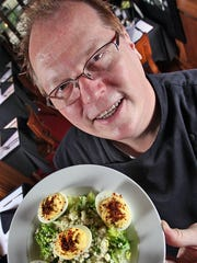 Chef Joseph Heidenreich shows off blue cheese deviled eggs at Chef Joseph's at the Connoisseur Room. The restaurant's last day of service is Dec. 31, 2017.