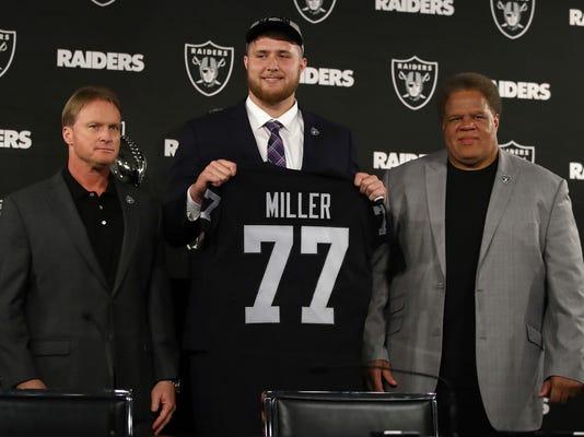 NFL_Raiders_Draft_Miller_Football_82001.jpg