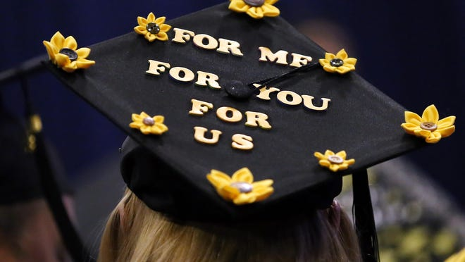 A graduate of the Great Bay Community College Class of 2018 expresses appreciation on her mortar board cap.