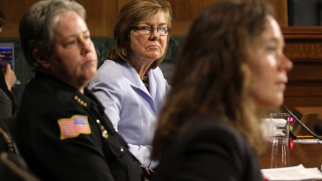 """Peg Langhammer, who runs Day One in Rhode Island, center, and Police Chief Kathy Zoner, left, listen as Angela Fleischer, assistant director of Student Support and Intervention for Confidential Advising at the Southern Oregon University, right, testifies on Capitol Hill in Washington on Tuesday before the Senate Crime and Terrorism subcommittee hearing: """"Campus Sexual Assault: the Roles and Responsibilities of Law Enforcement."""""""