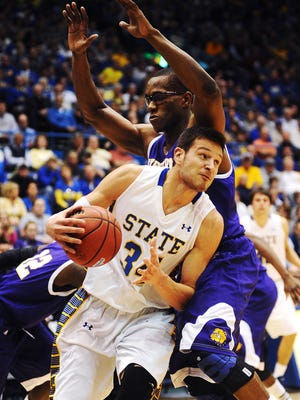 SDSU's #34 Cody Larson pushes past Western Illinois' #52 Michael Ochereobia during a Summit League Tournament quarterfinal game Sunday, March 9, 2014, at the Sioux Falls Arena in Sioux Falls. (Joe Ahlquist / Argus Leader)
