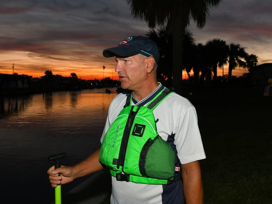 Scott Hoffman of Satellite Beach discusses the sewage situation, from Oars & Paddles Park in Indian Harbour Beach at sunset. He and his fellow paddlers have been concerned about the sewage discharged into the Indian River Lagoon system during and after Hurricane Irma.