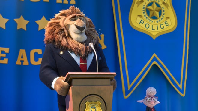 """This image released by Disney shows Mayor Lionheart, voiced by J.K. Simmons, left, and Assistant Mayor Bellwether, voiced by Jenny Slate, in a scene from the animated film, """"Zootopia."""" (Disney via AP)"""