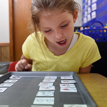 Norfork third-grade student Elizabeth Goldstein ponders