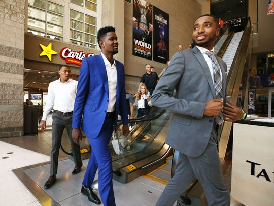 Phoenix Suns number one draft pick Deandre Ayton (center)