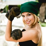 Tina Fleming, cosplaying as Winry Rockbell, strikes a Rosie-the-Riveter pose at MegaCon.