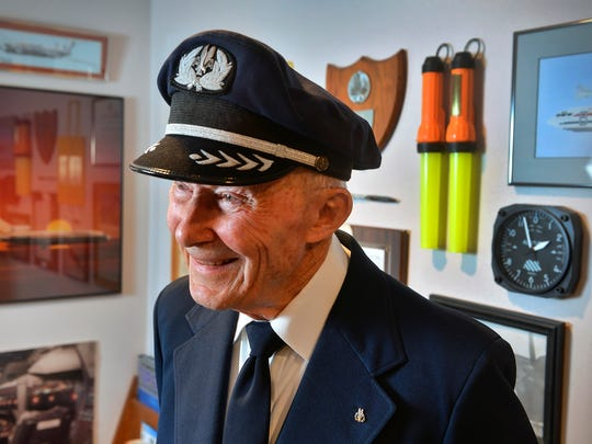 Retired American Airlines pilot Andy Anderson smiles Wednesday, April 6, as he talks in his St. Cloud home about the experience of being there in full uniform to pin wings on his granddaughter, Katie, as she became a flight attendant.