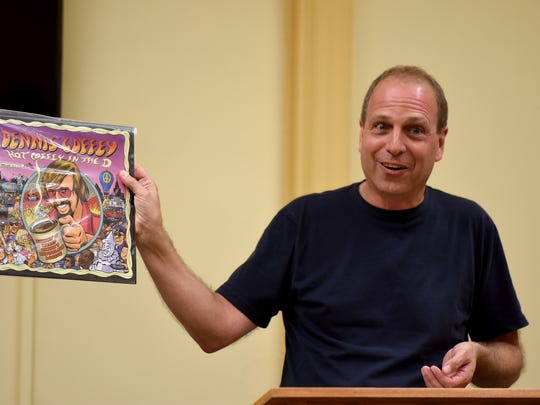 "Jon Lambert, owner of the Princeton Record Exchange, holds up the LP ""Dennis Coffey Hot Coffey in the D: Burnin' at Morey Baker's Showplace Lounge,"" during a talk at the Nutley Public Library on Tuesday, September 12, 2017."
