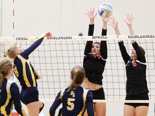 Brighton's Celia Cullen (14) and Brittnay Stahl attempt to block a shot by South Lyon's Jillian McKenna.