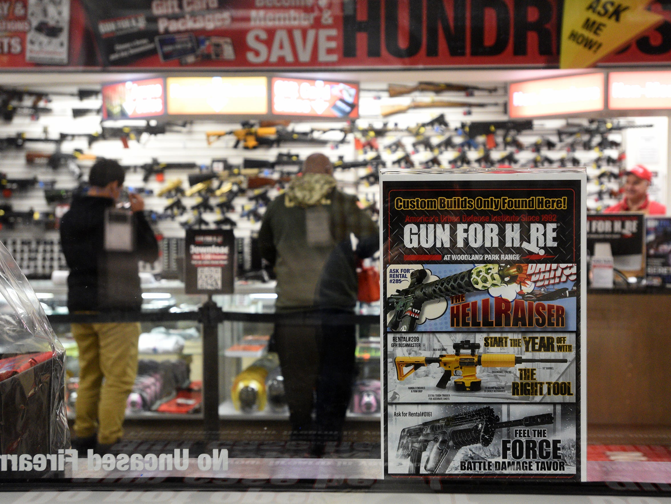 An advertisement at Gun For Hire in Woodland Park shows