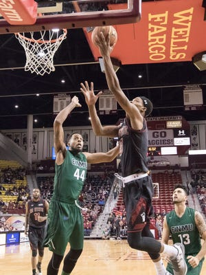New Mexico State's Jemerrio Jones goes for the layup in the first half against Eastern New Mexico Tuesday night at the Pan American Center.