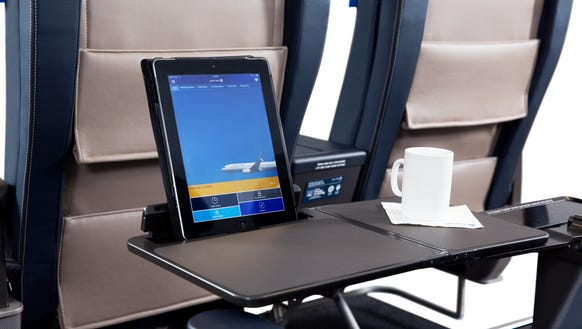 Tray tables have a mobile device holder that allows
