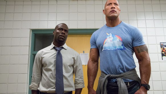 "Kevin Hart (left) and Dwayne Johnson play old high school pals on a misadventure in ""Central Intelligence."""