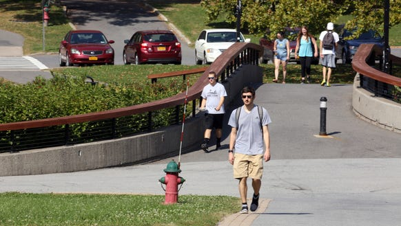 Students walk on campus at SUNY New Paltz Sept. 27,