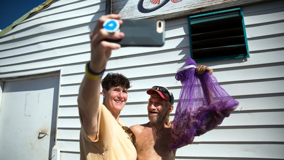 Pat Muller, left, takes a selfie with Scott Cowles,