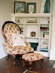 "This undated photo provided by the F. Scott and Zelda Fitzgerald Museum in Montgomery shows a pillow on a chair embroidered with a quote from Zelda Fitzgerald: ""She refused to be bored chiefly because she wasn't boring."" The chair is in an apartment upstairs from the museum. The apartment and museum are located in a 1910 house where the Fitzgeralds lived in the 1930s."