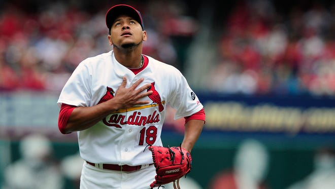 Cardinals starter Carlos Martinez reacts after getting the third out of the second inning Sunday.