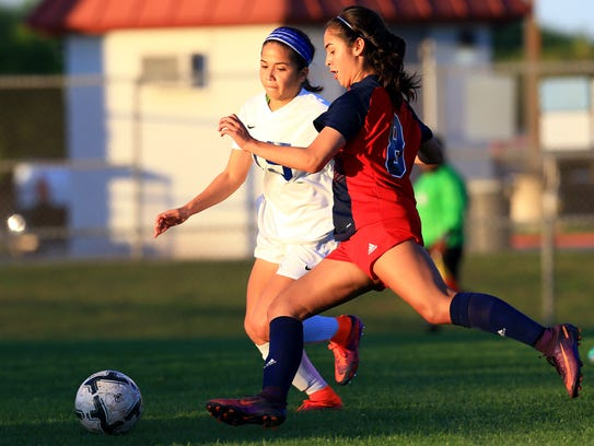 Veterans Memorial's Sierra Posada kicks the ball against