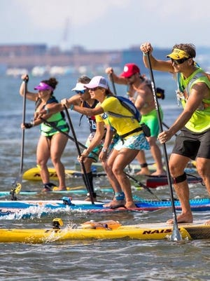 Athletes from all over the world participating in the grueling 25-mile stand-up paddle race around Manhattan, SEA Paddle NYC.