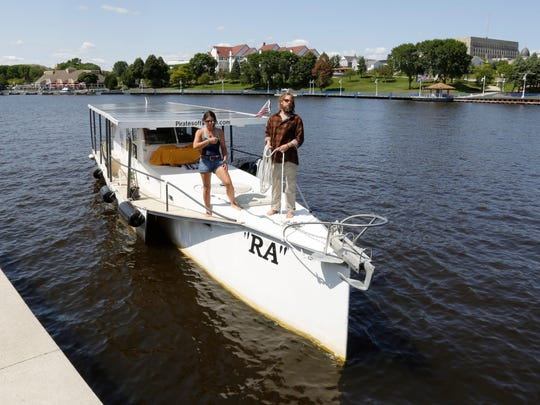 "Jennifer Mays, left, and Travis Lay observe while docking the solar-powered ""RA"" at the Sheboygan riverfront Friday, August 25, 2017, in Sheboygan, Wis."