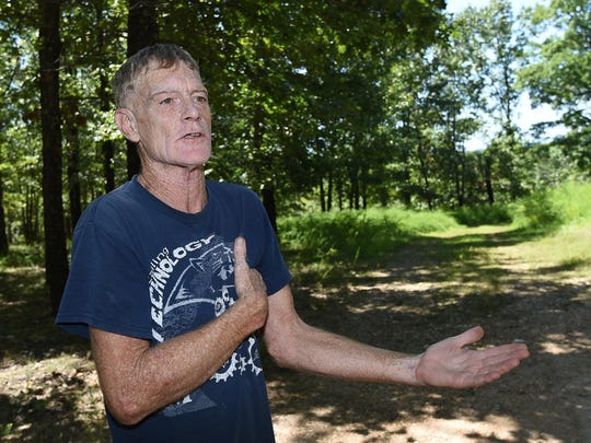 Mark Pierce, of Howards Ridge, Mo., talks Tuesday about the discarded military headstones he used to make a patio and walkway at his house. When they were discovered, Pierce volunteered to have them removed.