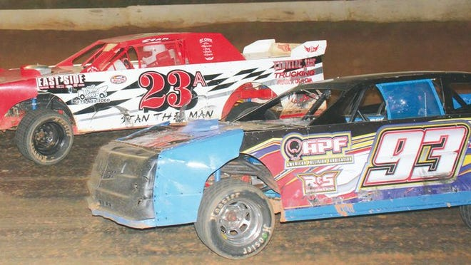 Danny Southerland (93) and Stan Anderson (23A) race for the lead in the Grand National feature race on Aug. 22 at Crawford County Speedway. Southerland has won 11 feature races this season.
