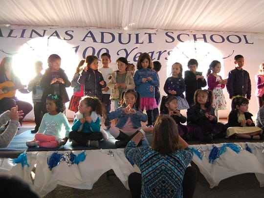 Children from the Salinas Adult School's Parent Center perform at the Salinas Adult School's 100th anniversary celebration on Thursday.