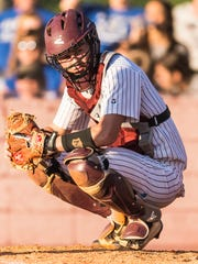 Breaux Bridge catcher Tyler Thibodeaux looks for the sign from the bench during the Class 4A quarterfinals win over DeRidder on May 5.