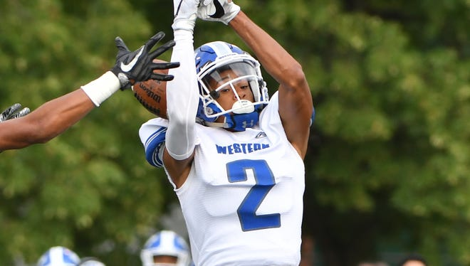 "Walled Lake Western cornerback Randall Harris said signing with Central Michigan was ""an easy decision."""