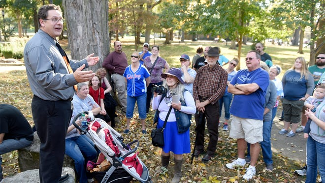 """Local historian Frank Nally speaks about the first and only """"dog supper"""" held on the courthouse square during the Spooks and Legends Tour in Downtown Henderson Saturday.  The guided tour offered some of the grisly stories about Henderson's past."""