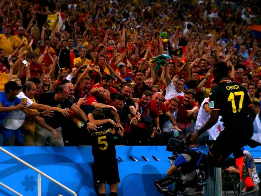 Group H: Belgium's Jan Vertonghen celebrates with fans after scoring against South Korea.