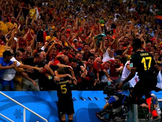 Group H: Belgium's Jan Vertonghen celebrates with fans after scoring against South Korea.
