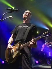 Everclear's Art Alexakis plays his guitar during performance at Asbury Park's Convention Hall in 2001.